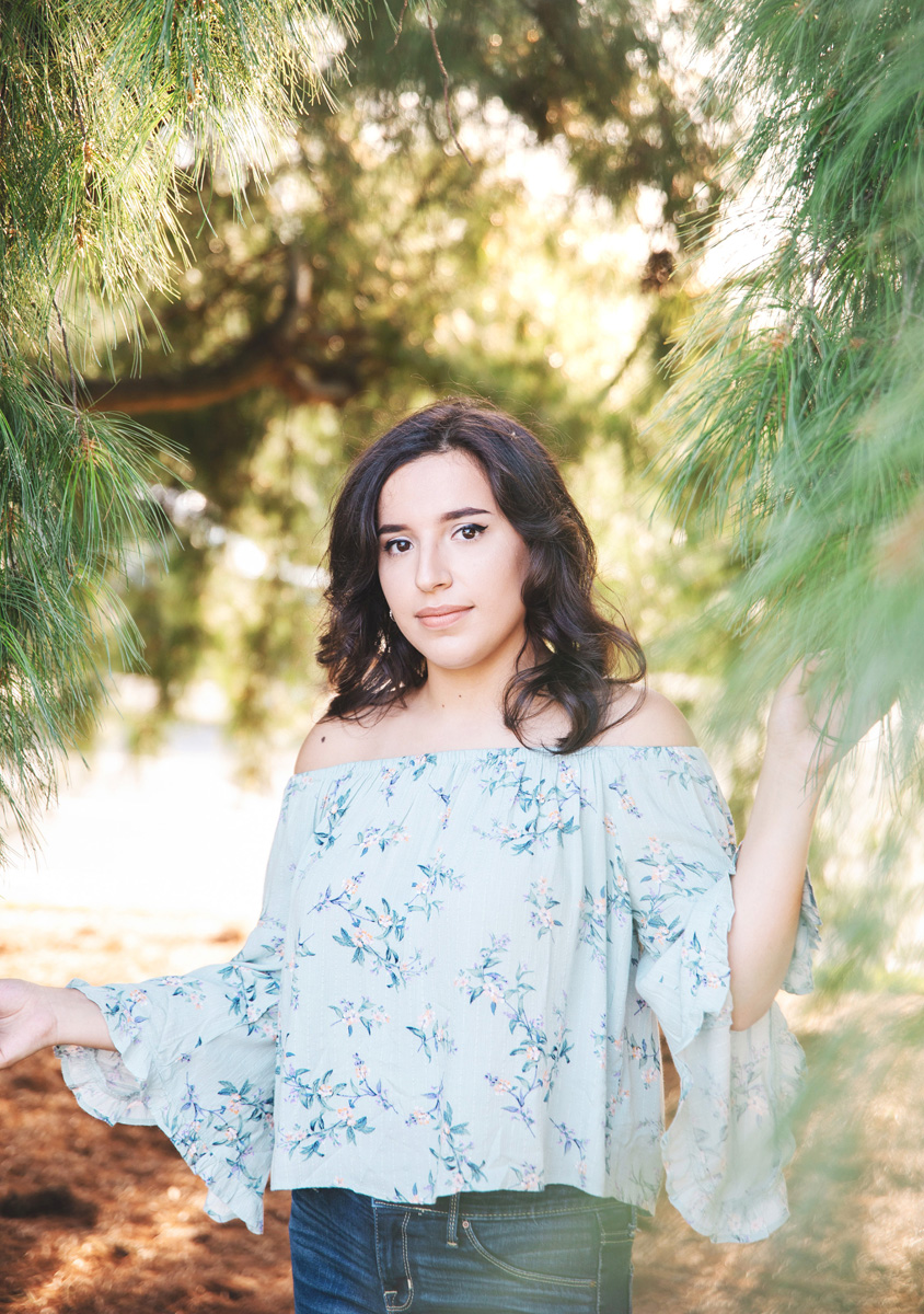 Senior portrait in pine trees at UMass Amherst by Monika Normand Photography