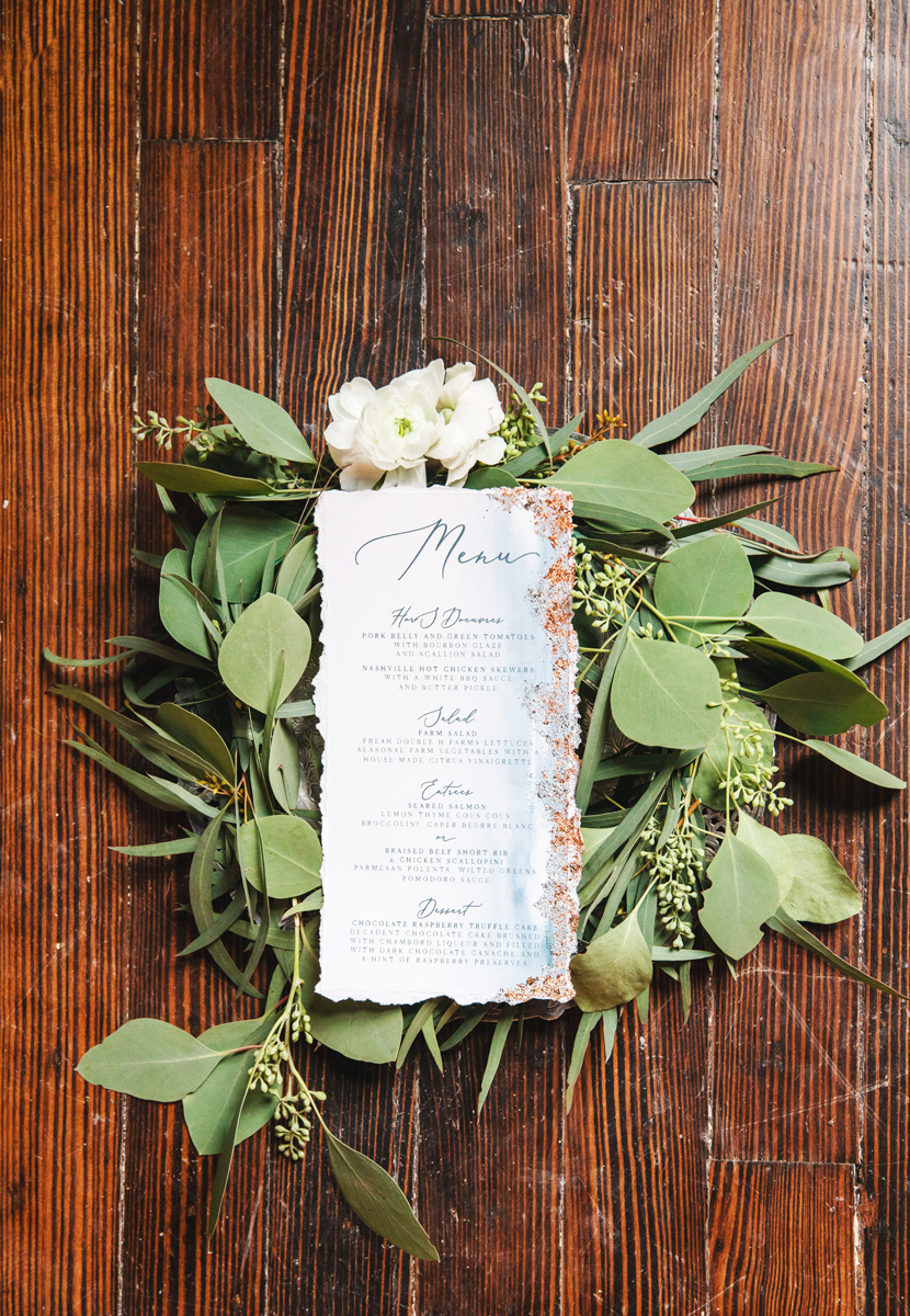 Wedding menu with greenery by Monika Normand Photography