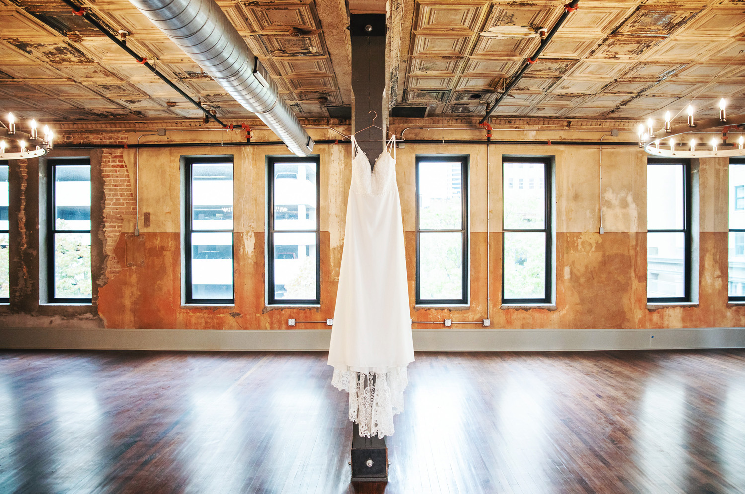 Wedding dress in renovated loft by Monika Normand Photography